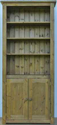 Hampshire pine bookcase with lower cupboard